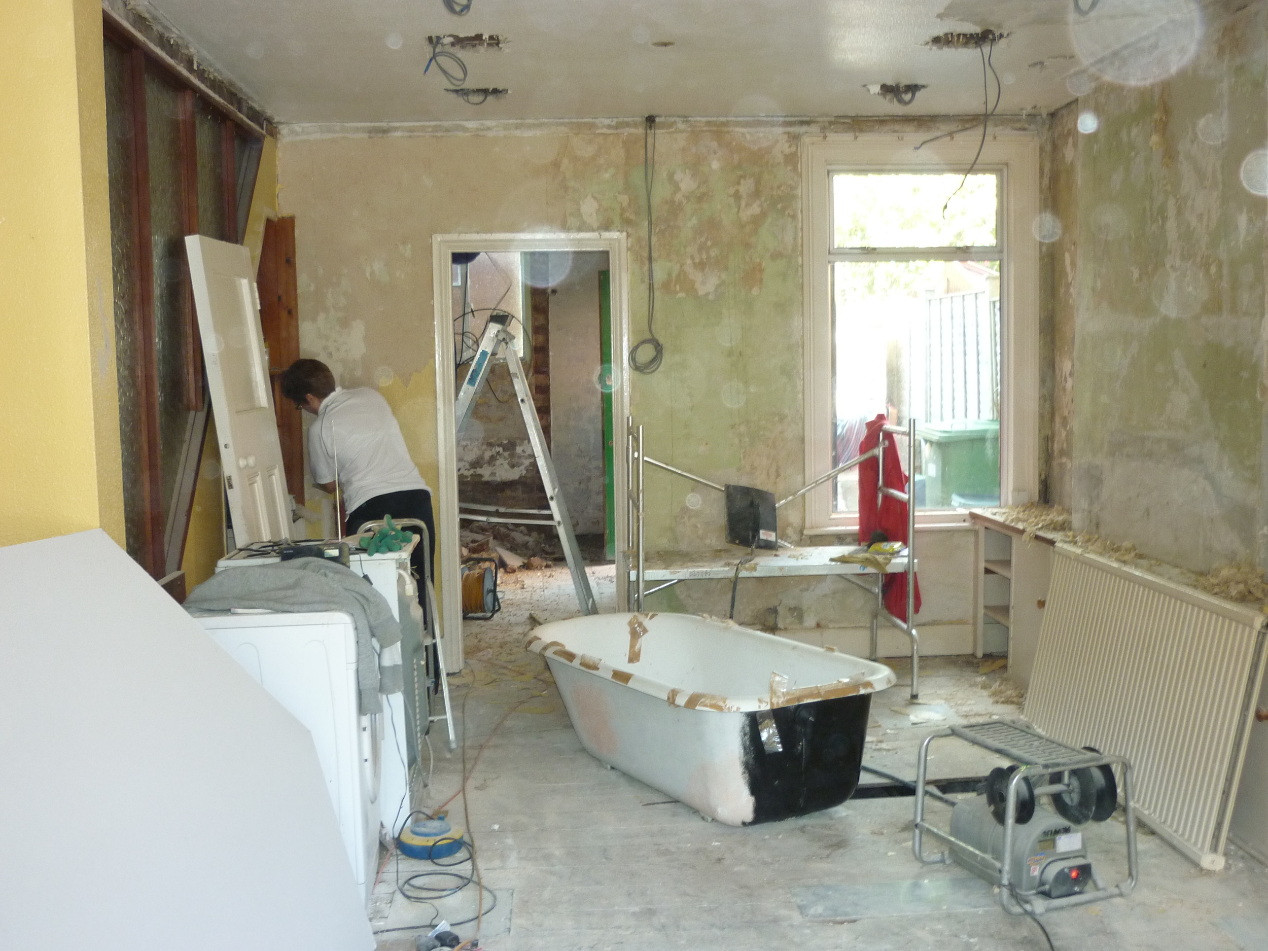During:  Yep - that's a bath in the centre (a second-hand cast iron roll-top bath we upcycled), plus two refurb essentials -a professional wallpaper steamer and Mama B.