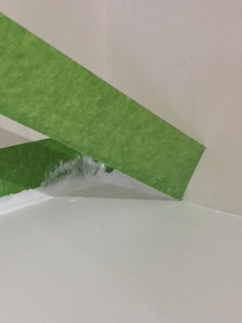 Peel away the FrogTape gently to avoid taking any wall paint off with it.