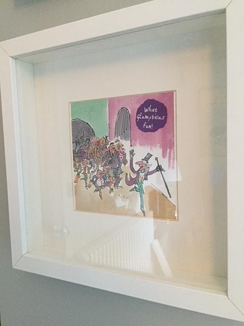 Framed Charlie and the Chocolate Factory card in our new nursery. (Cheaper than buying official prints.)