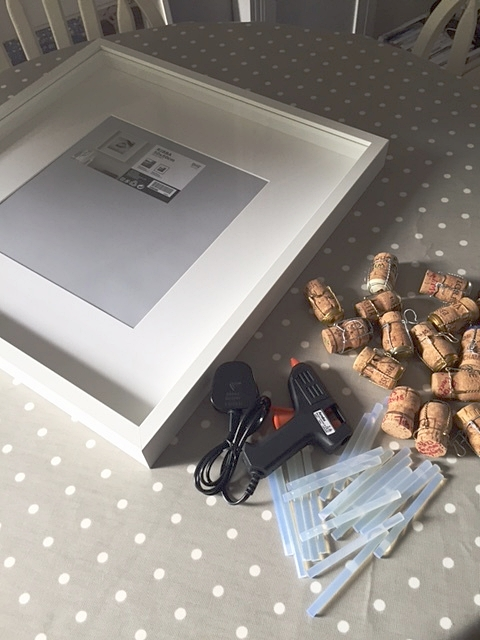 All you need: box picture frame (glass removed), corks & a glue gun.