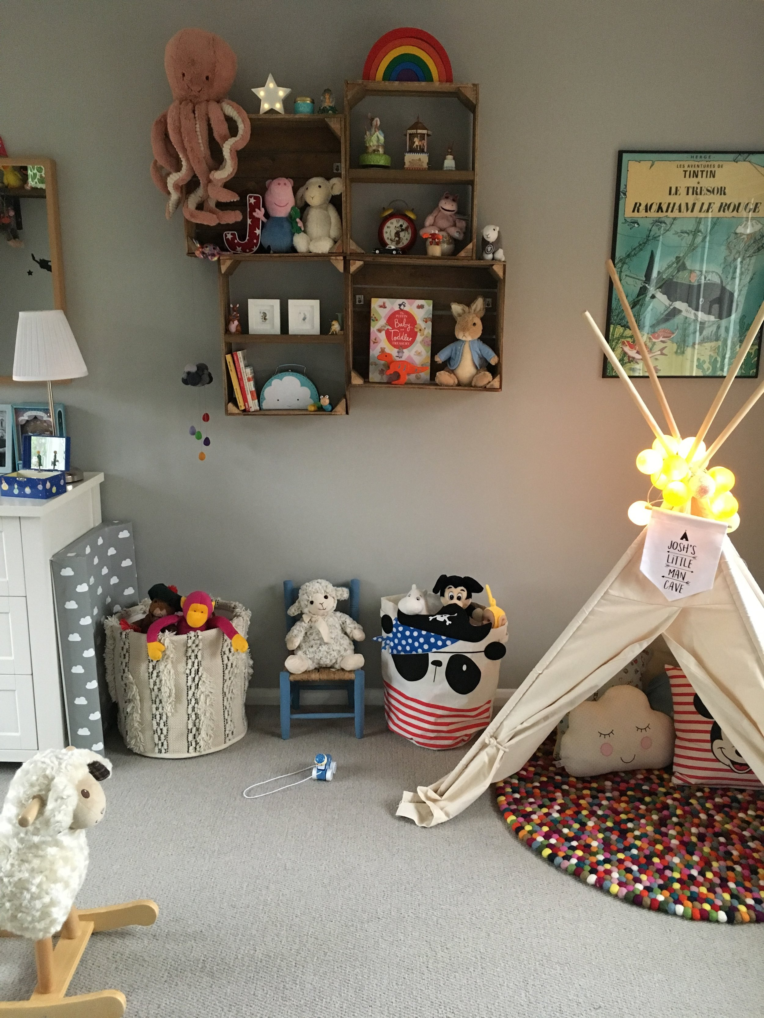 Crate shelves, made by L. Teepee from  Not On The High Street , sheep rocker from  John Lewis , rug from  Sukhi Rugs , storage baskets from  HomeSense  and  Dunelm .
