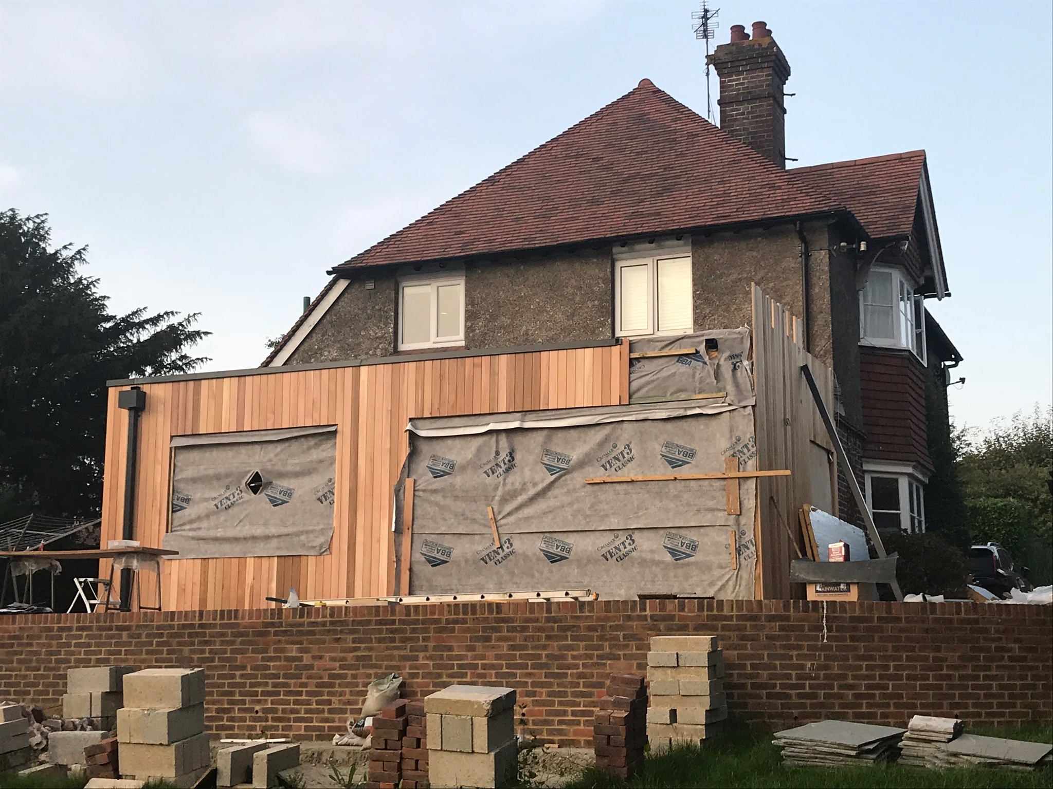 Cedar cladding goes on - can't wait for it to turn grey-ish over time (and to start work on the rest of the exterior!).