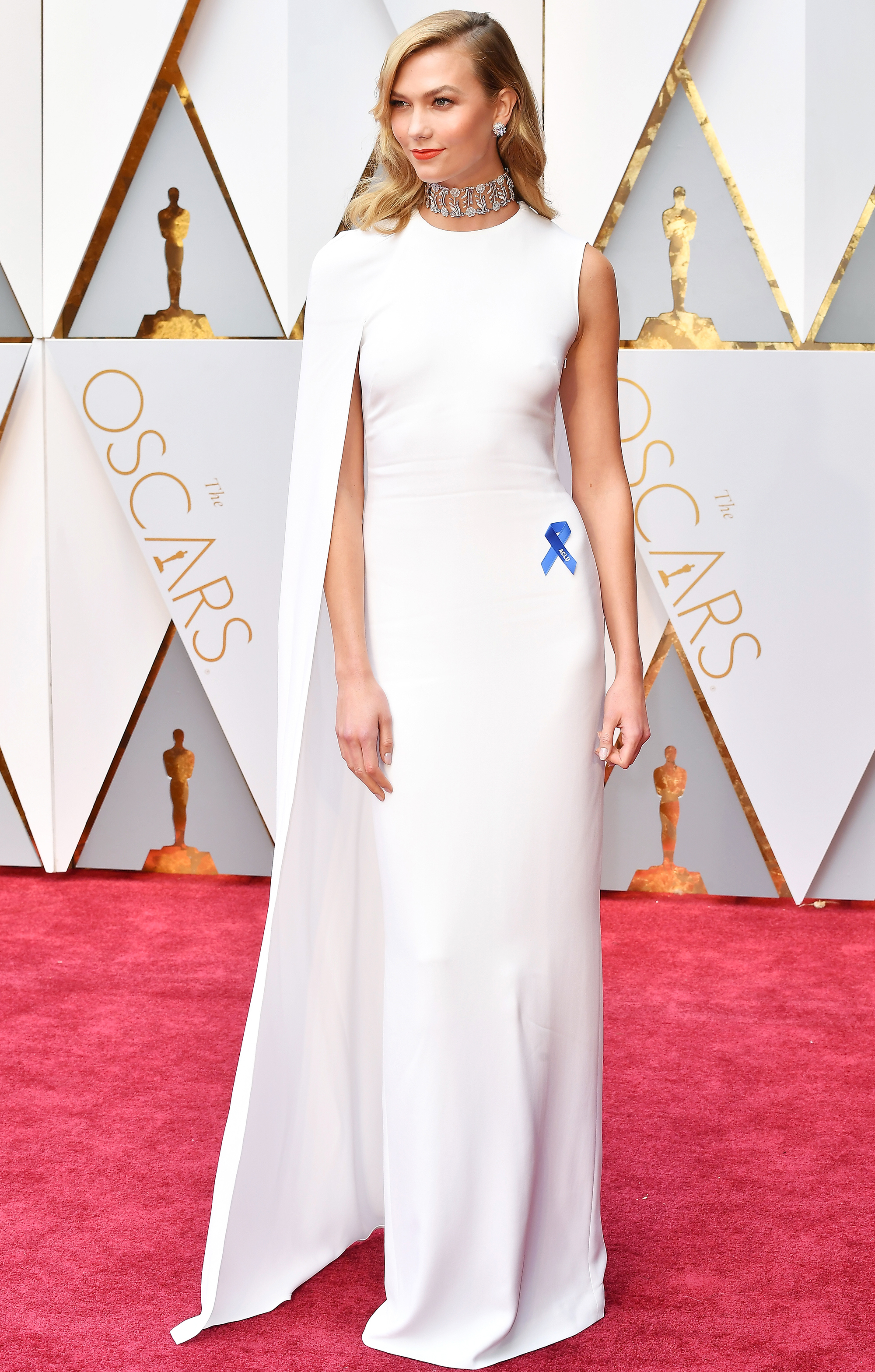 Karlie Kloss wears Stella McCartney and her ACLU blue ribbon.