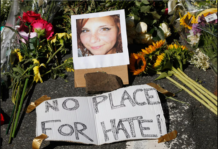 Flowers and a photo of Heather Heyer, who was killed during protests against white supremacists, sits in Charlottesville on Sunday. (Steve Helber/AP)