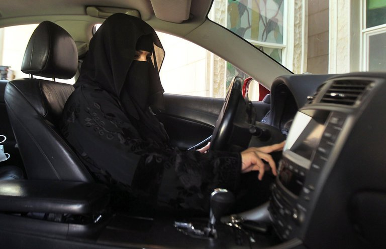 A woman driving a car in Saudi Arabia in 2013. CreditFaisal Al Nasser/Reuters