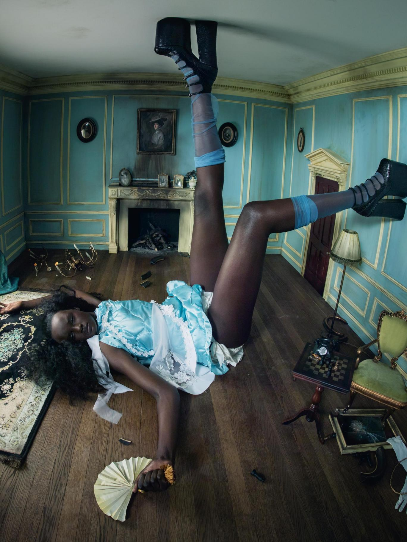 Duckie Thot as Alice in the 2018 Pirelli Calendar