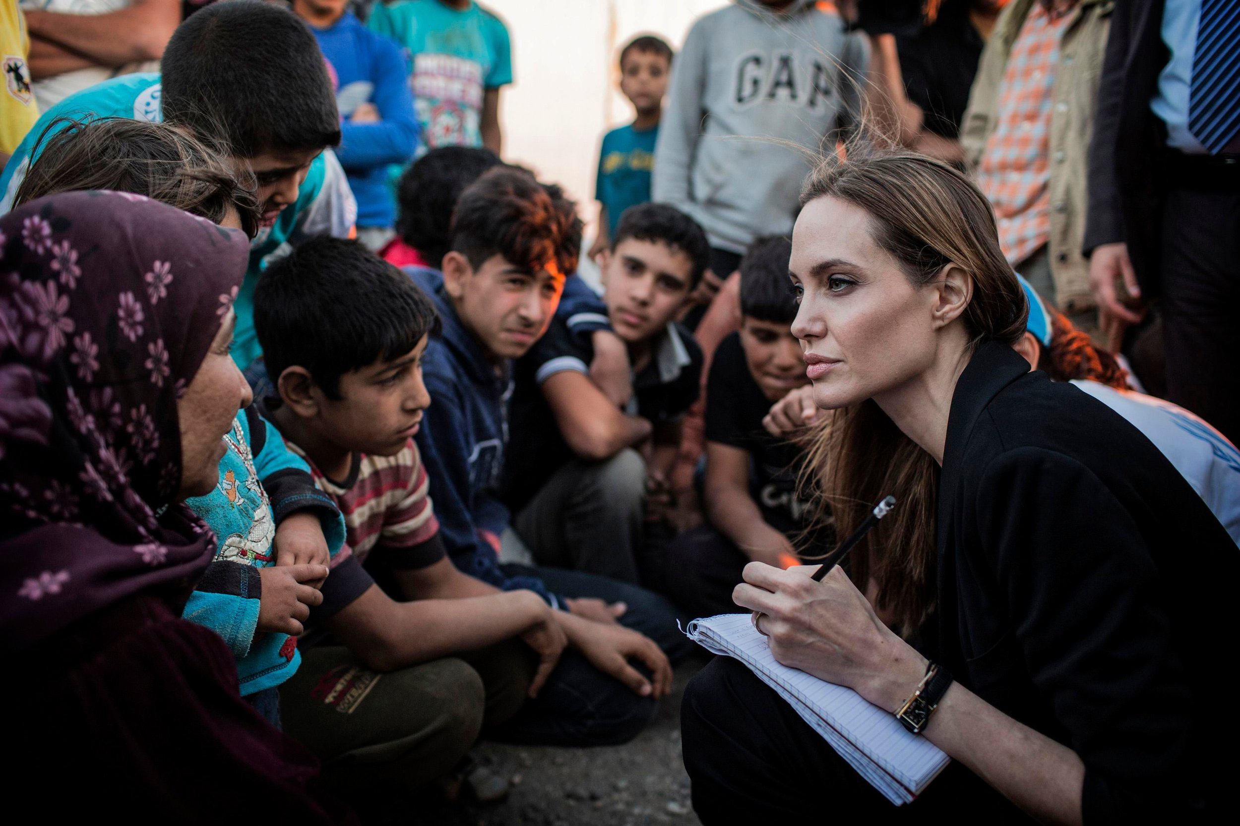 Angelina Jolie taking notes in a Syrian refugee camp in Jordan, February 2017.