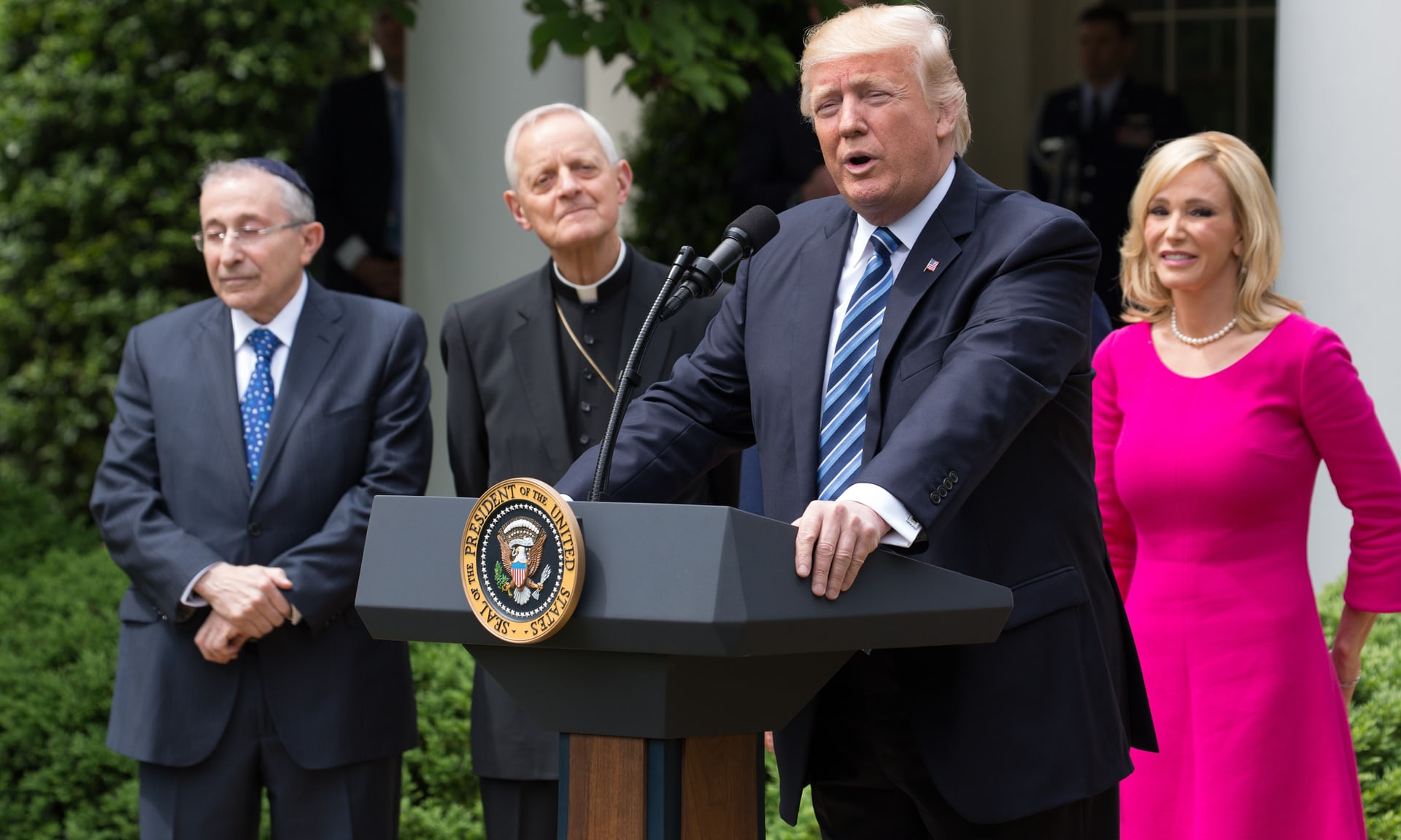 Donald Trump with Rabbi Marvin Hier, Cardinal Donald Wuerl and Pastor Paula White in the Rose Garden of the White House. Photograph: NurPhoto/NurPhoto via Getty Images