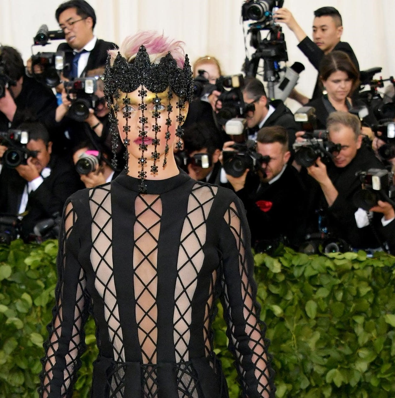 Cara Delevigne dressed for confession at Met Gala.jpg