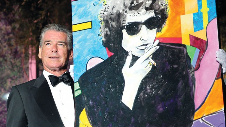 Gisela Schober/Getty Images. Brosnan and his painting in Cannes.