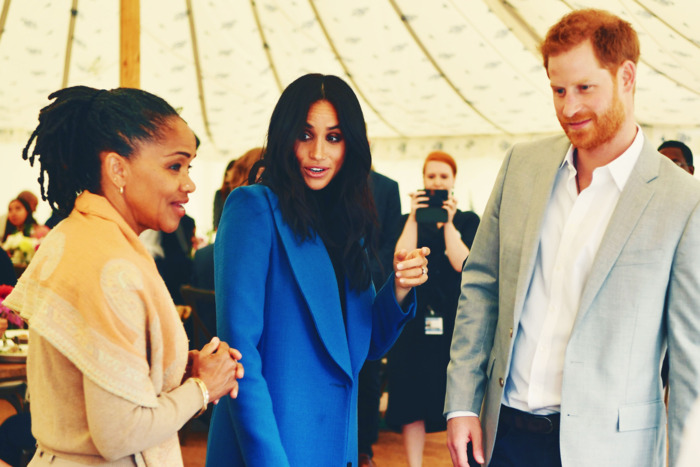 Doria Ragland, Meghan Markle, and Prince Harry at the lunch celebrating Meghan's new cookbook. Photo: BEN STANSALL/AFP/Getty Images