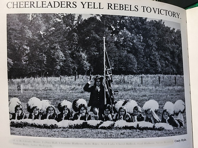 U.S. Sen. Cindy Hyde-Smith appears third from the right in a 1975 yearbook photo of cheerleaders at Lawrence County Academy. The mascot appears in the middle dressed as a Confederate colonel holding a rebel flag.  via  Jackson Free Press
