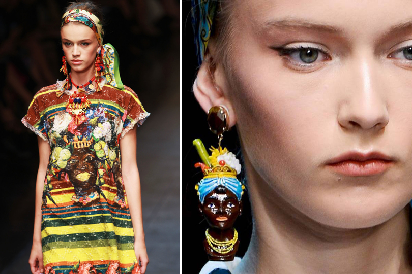Above: Models walk the runway at Dolce & Gabbana's spring 2013 runway show wearing dresses with blackamoor imagery and black figurine earrings