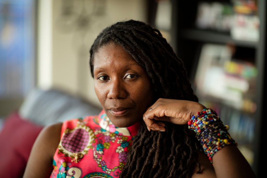 "Nicole Dennis-Benn, the author of ""Here Comes the Sun,"" was raised in Kingston, Jamaica.. Credit: Tony Cenicola/The New York Times"