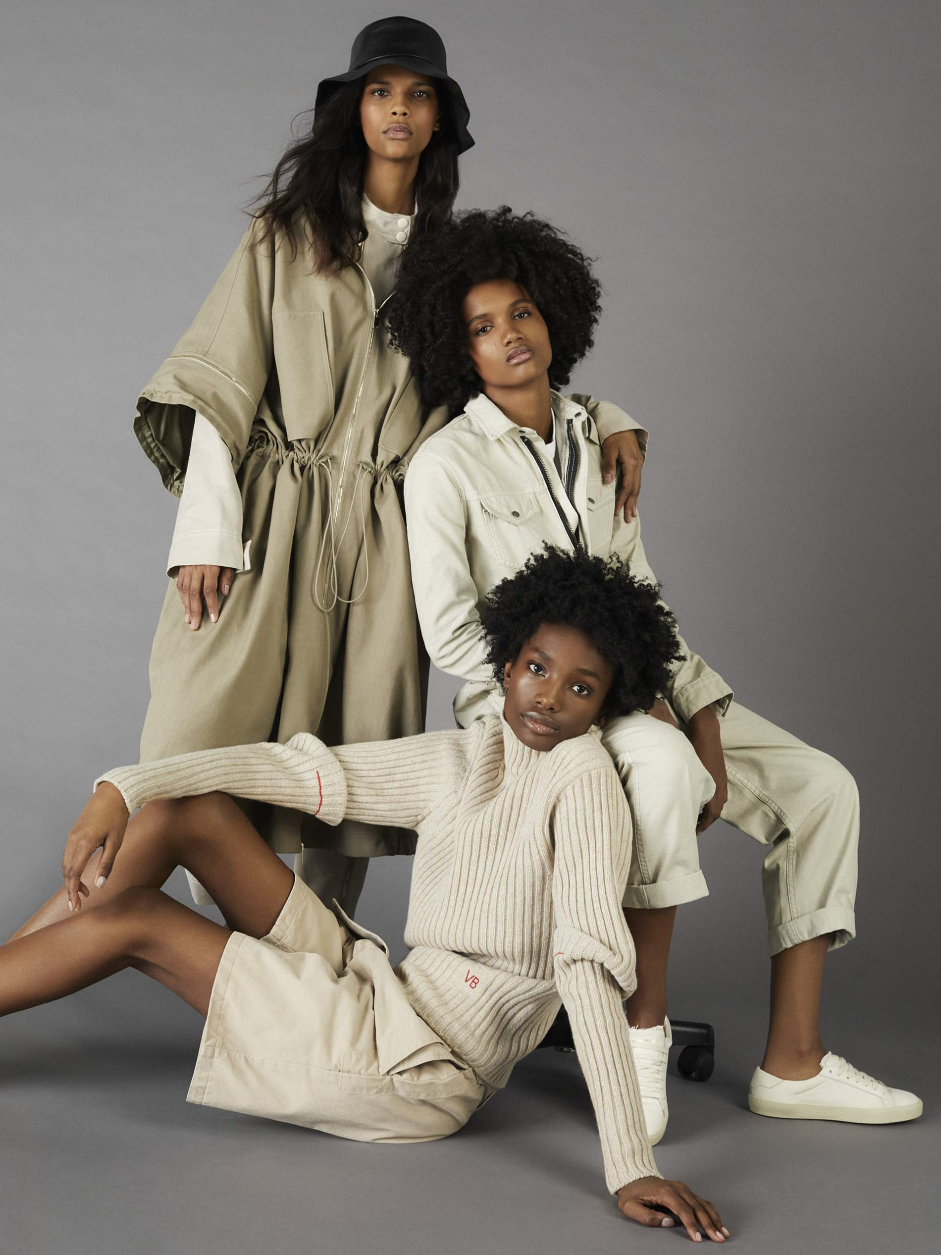 Colombian model Natalia Montero (l), Dominican model Ambar Cristal (c), American-Kenya model Imari Karanja (r seated on floor)