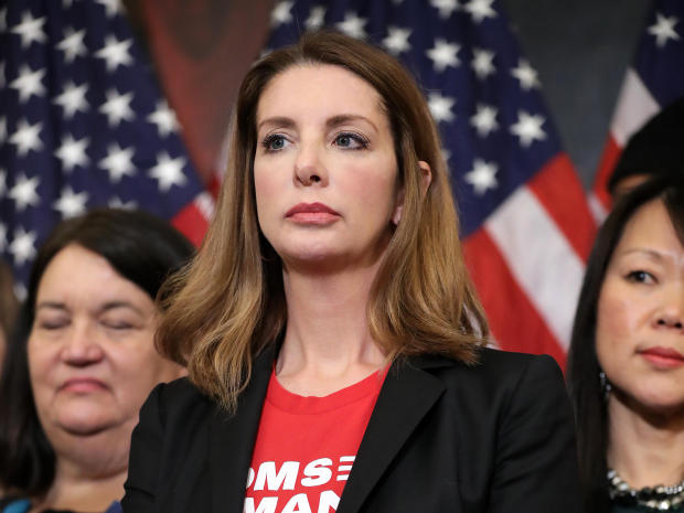 Moms Demand Action for Gun Sense founder Shannon Watts joins other gun-safety advocates for a news conference to introduce legislation to expand background checks for firearm sales in the Rayburn Room of the U.S. Capitol Jan. 8, 2019, in Washington.  via CBS News