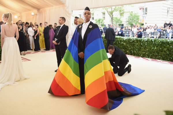 Lena Waithe at the 2018 Met Gala wearing a rainbow pride flag cape designed by Carolina Herrera. (Getty Images  via The Evening Standard.)