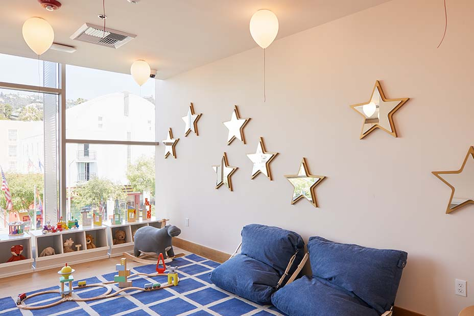 The Little Wing daycare center is equipped with Crate & Kids decor, toys and balloon-shaped lights on the ceiling.Image Madeline Tolle/The Wing.