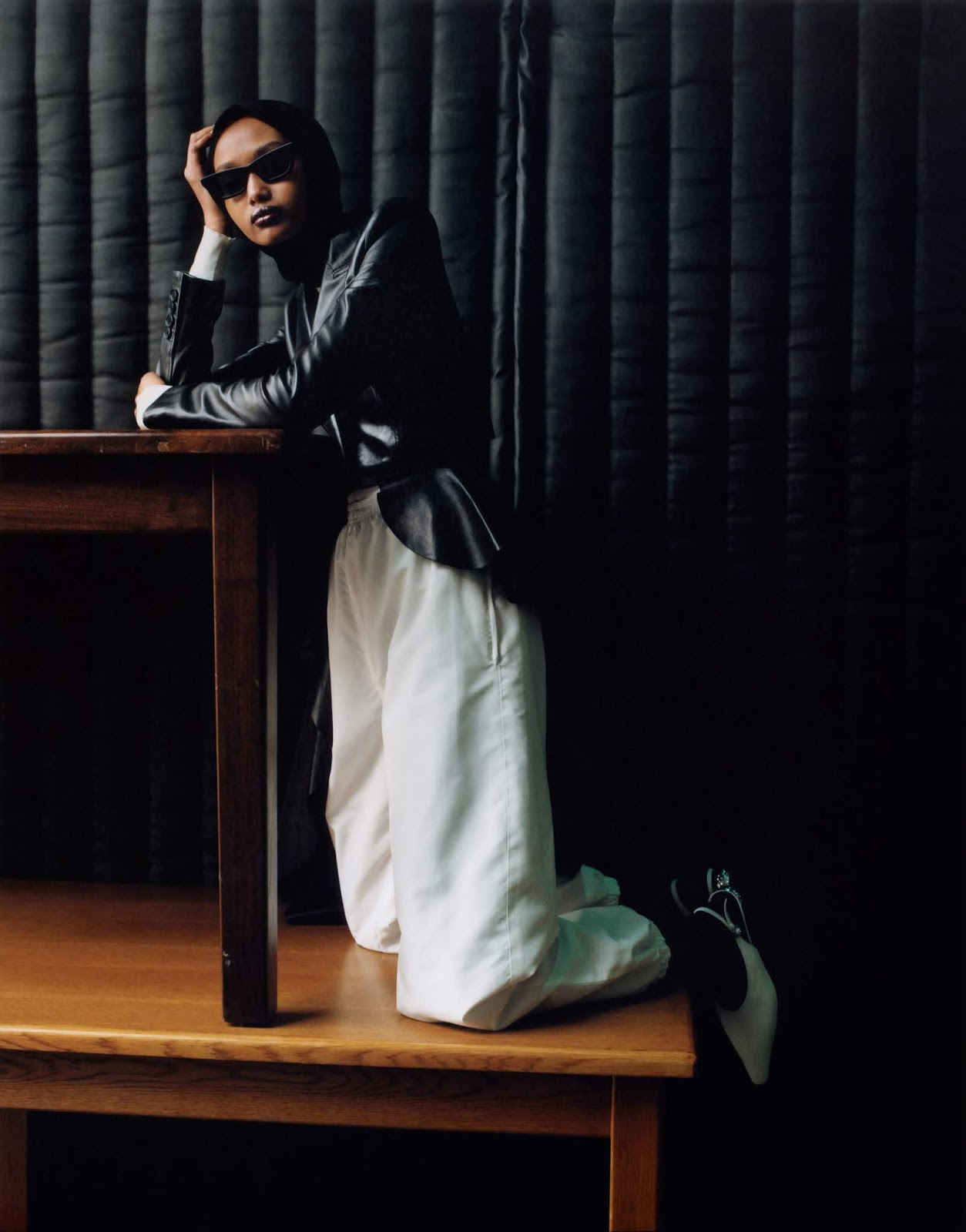 Ugbad Abdi by Zoe Ghertner. Jacket Alexander McQueen. Rollneck The Row. Tracksuit Bottoms Stylist's Own. Tights WOLFORD. Headscarf Berwick St. Cloth Shop. Sunglasses Gentle Monster. Shoes Yuul Yie.