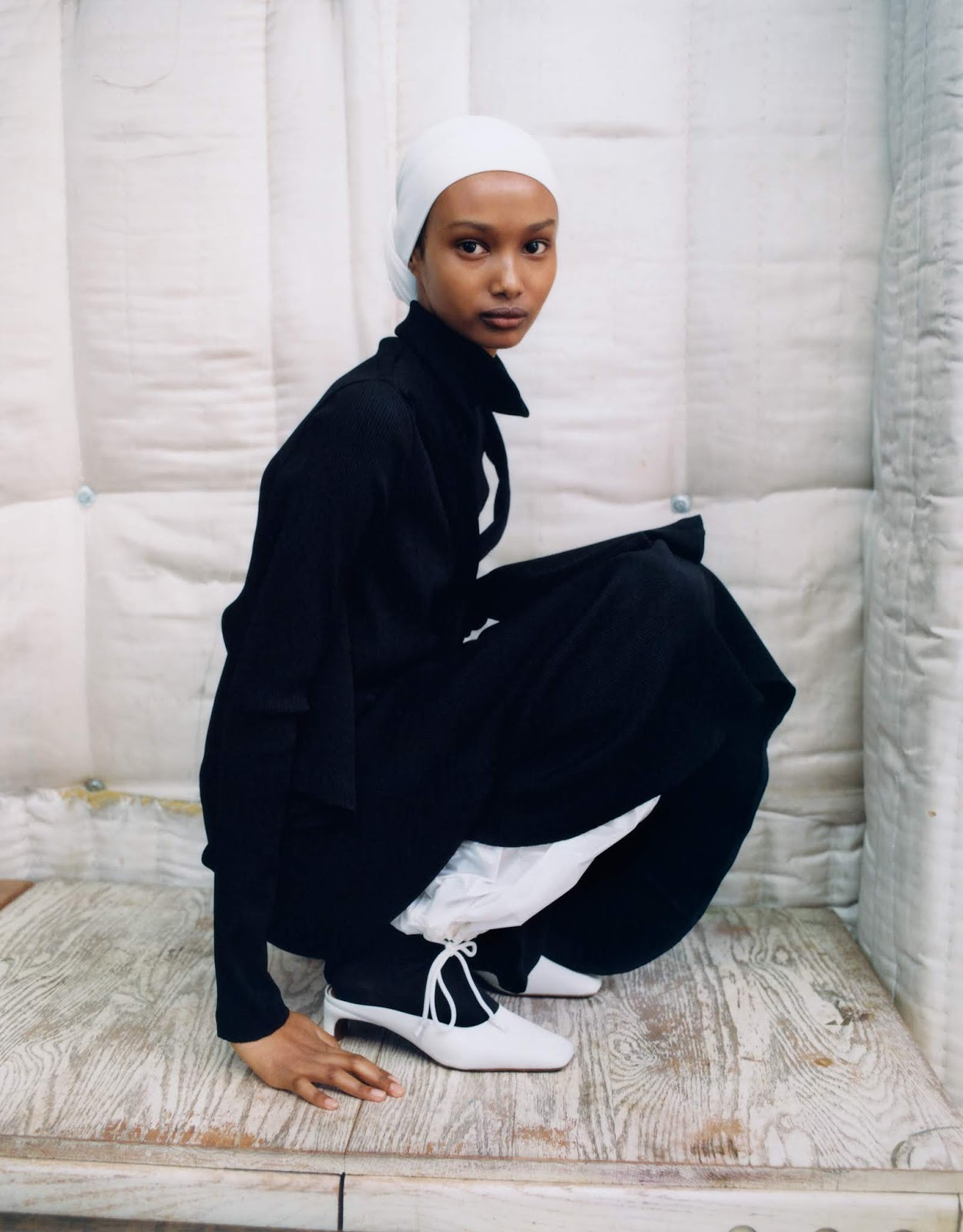 Ugbad Abdi by Zoe Ghertner. Dress Christopher Kane. Trousers Kwaidan Editions. Headscarf Berwick St. Cloth Shop. Socks Falke. Shoes by FAR.