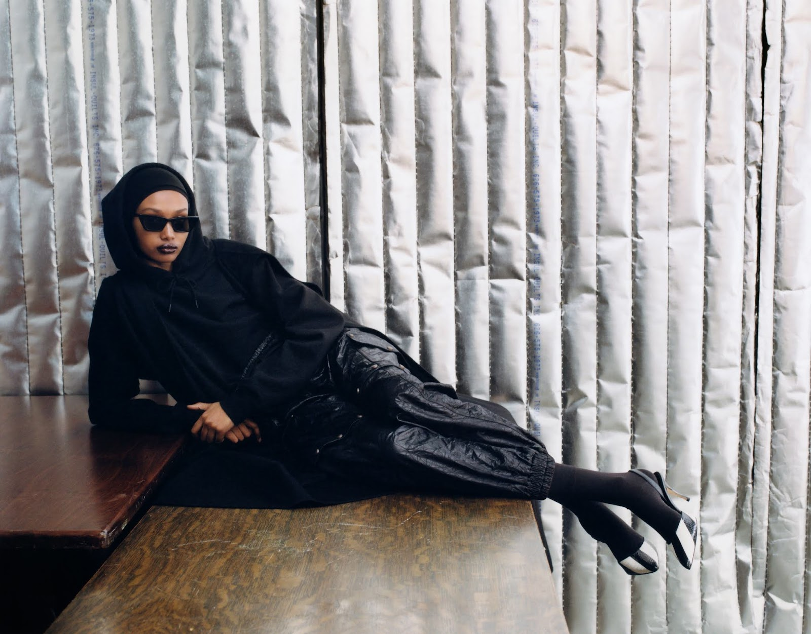 Ugbad Abdi by Zoe Ghertner. Cape Valentino. Hoodie Wardrobe NYC. Tracksuit bottoms Gucci. Headscarf Berwick St. Cloth Shop. Sunglasses Gentle Monster. Socks Falke. Shoes Manolo Blahnik.