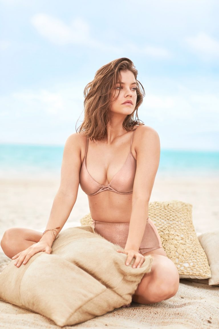 Barbara Palvin wonders is it's time for a siesta on Miami Beach sands.