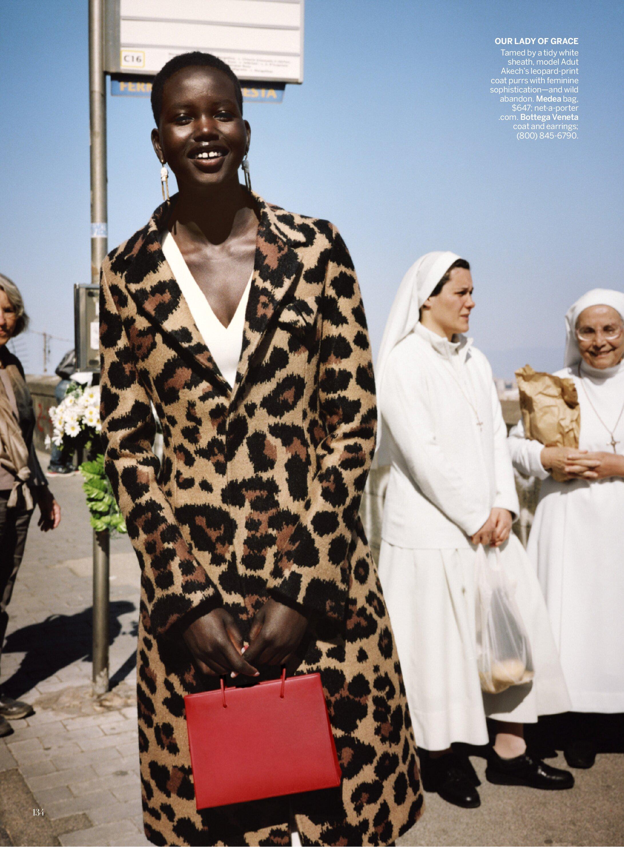 Adut Akech by Angelo Pennetta in leopard pattern coatdress for American Vogue.