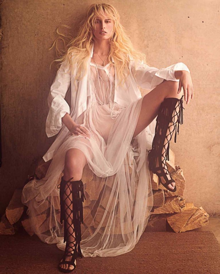 Karolina Kurkova wears Ann Demeulemeester cotton shirt and silk dress with Longchamps leather and velvet sandals.