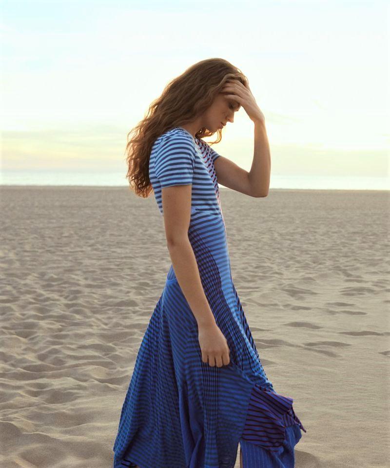 Adam Franzino Flashes Adrienne Jüliger Wearing Asymetrical Stripes At The Beach