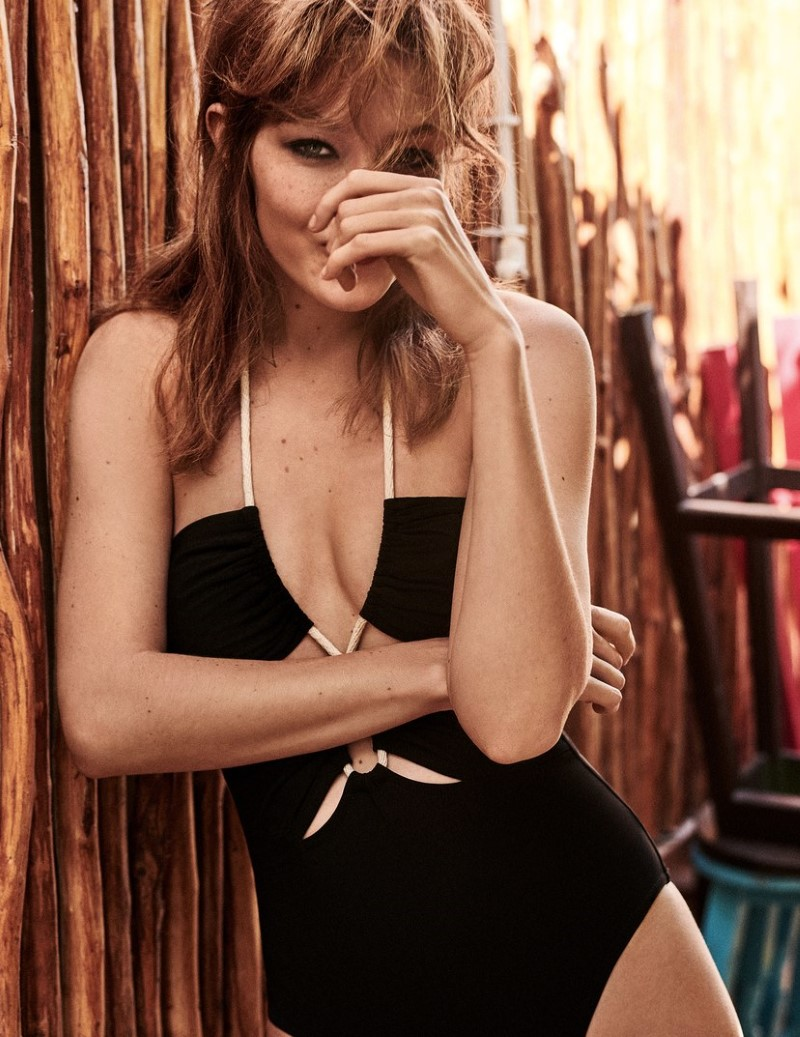 Gigi Hadid Teases With A Wry Smile Lensed By Giampaolo Sgura in a Beautiful Black Swimsuit