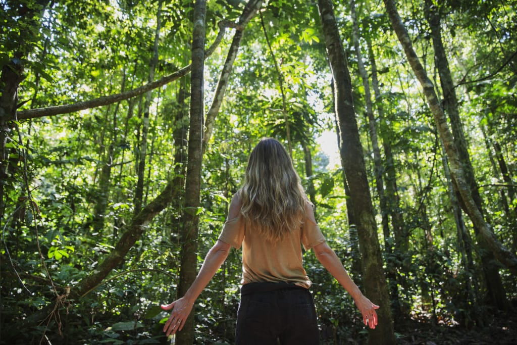 Gisele in the Amazon rainforest, talking climate change impact on trees for National Geographic.