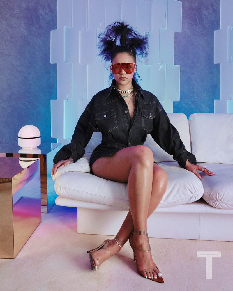 Corset dress in Japanese denim, $810. Sunglasses, $480. Leather shoes, $625. All clothing and accessories are by Fenty, fenty.com . Jewelry, unless noted, is Rihanna's own. images by Kristin-Lee Moolman.