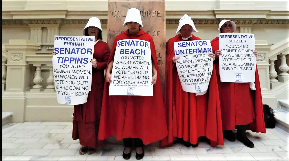Georgia Handmaids promise a fight at the Georgia ballot box. Given the intense activism generated by Stacey Abrams' governor's race among women of color and white suburban women both, the Handmaid threats may bring ballot box results.