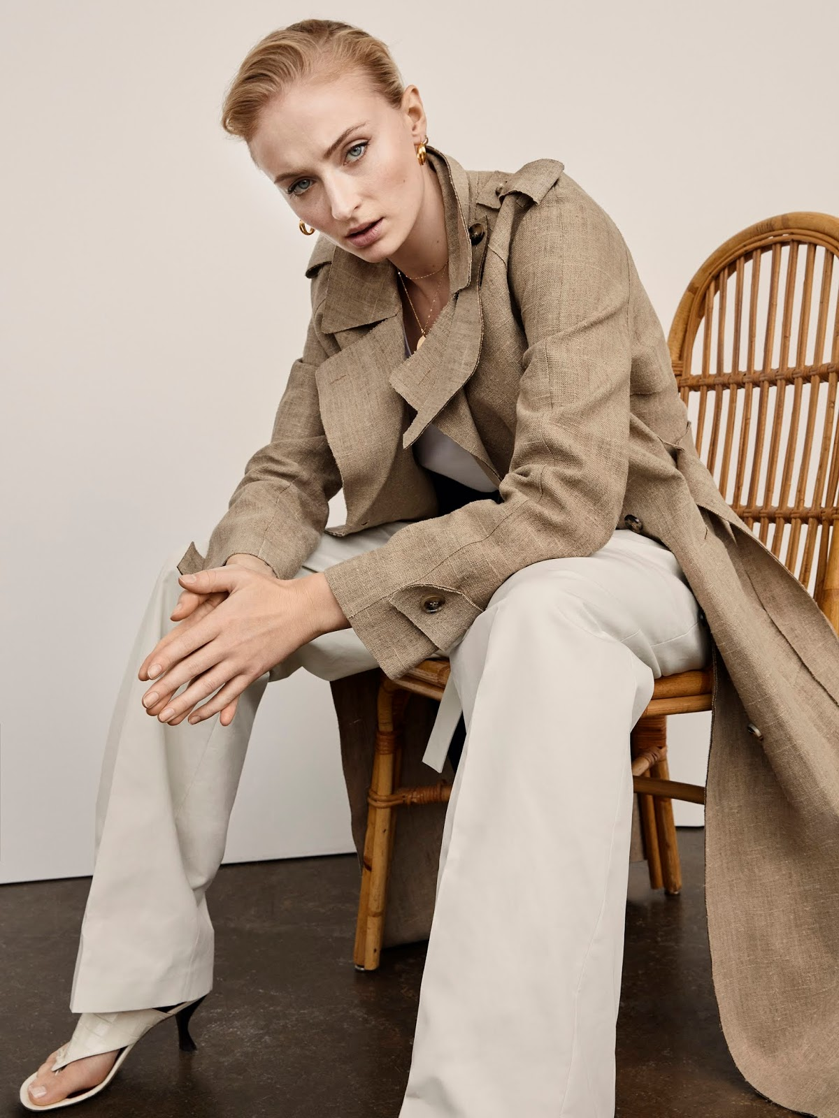 Yelena Yemchuk captures Sophie wearing Bottega Veneta coat, ATM Anthony tank and Thomas Melillo pants.
