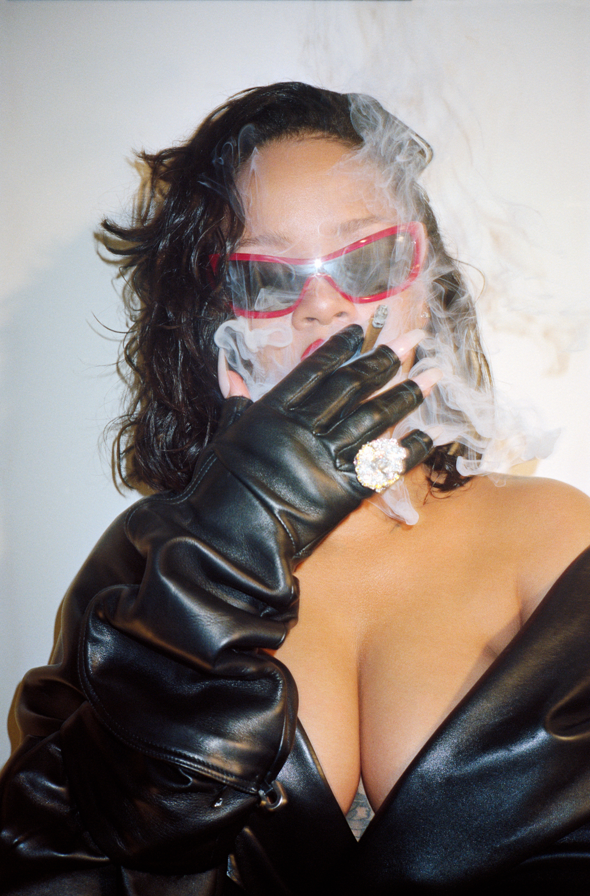 Coat by  Balenciaga.  Sunglasses by  Adam Selman x Le Specs.  Earrings and Ring by  Dior Fine Jewelry. Gloves by Rick Owens.