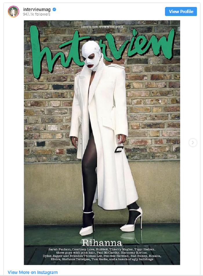 On the cover, the pop star, 31, wears a white Saint Laurent trench coat and matching pumps, black stockings and a white leather bondage hood by A.F. Vandevorst x Zana Bayne.