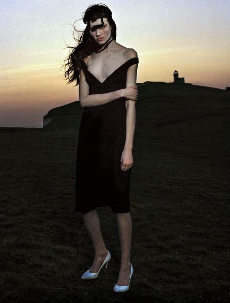 Dress by  Prada.  Headpiece by  Craig Green.  Shoes by  Stuart Weitzman.