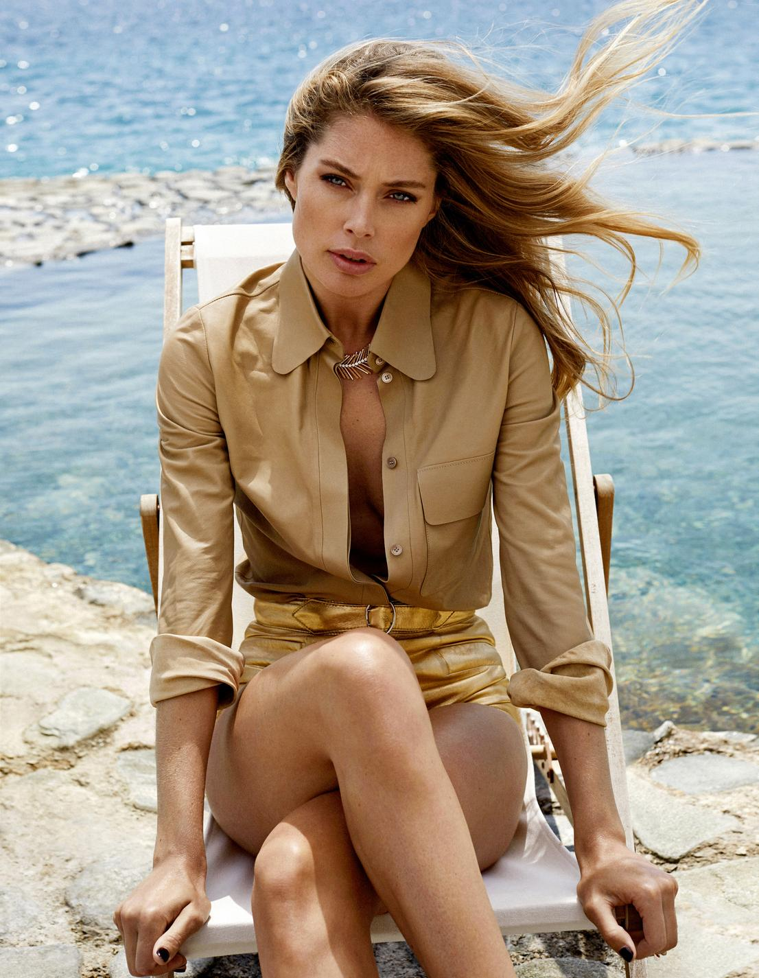 Doutzen Kroes wears a leather shirt, Tod's, and gold leather shorts, Miu Miu. Desert Palm necklace, in pink gold and diamonds, Golden Oasis collection, and Possession ring, Piaget. Image by Xavi Gordo.