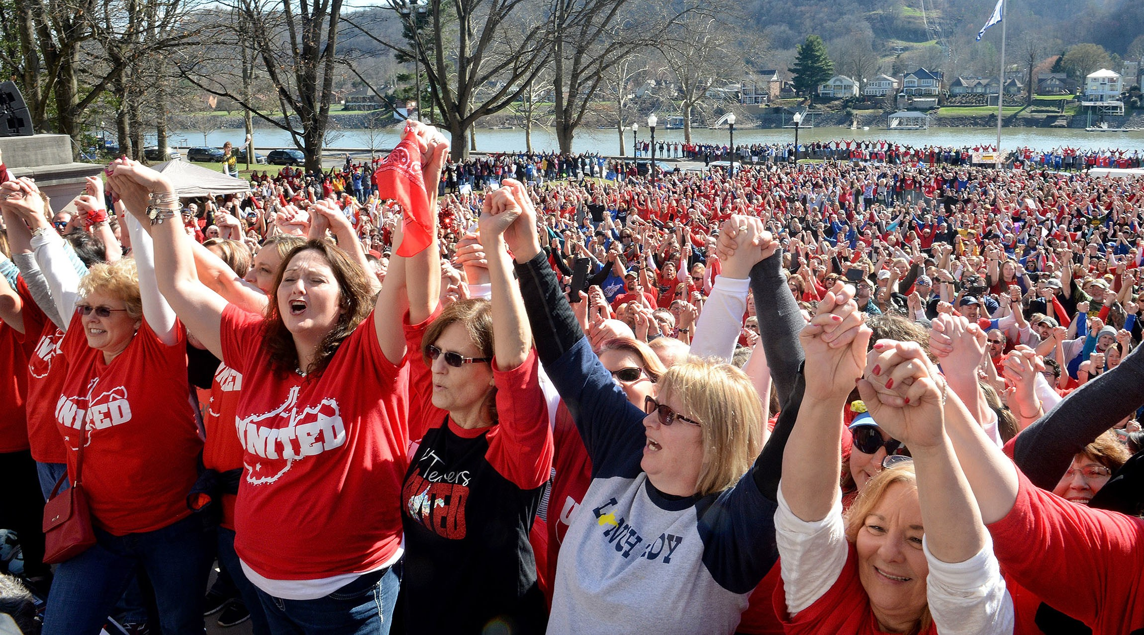 Striking teachers grasp hands during a rally at the West Virginia Capitol in Charleston. (Chris Dorst/Charleston Gazette-Mail via AP)    via Washington Examiner.