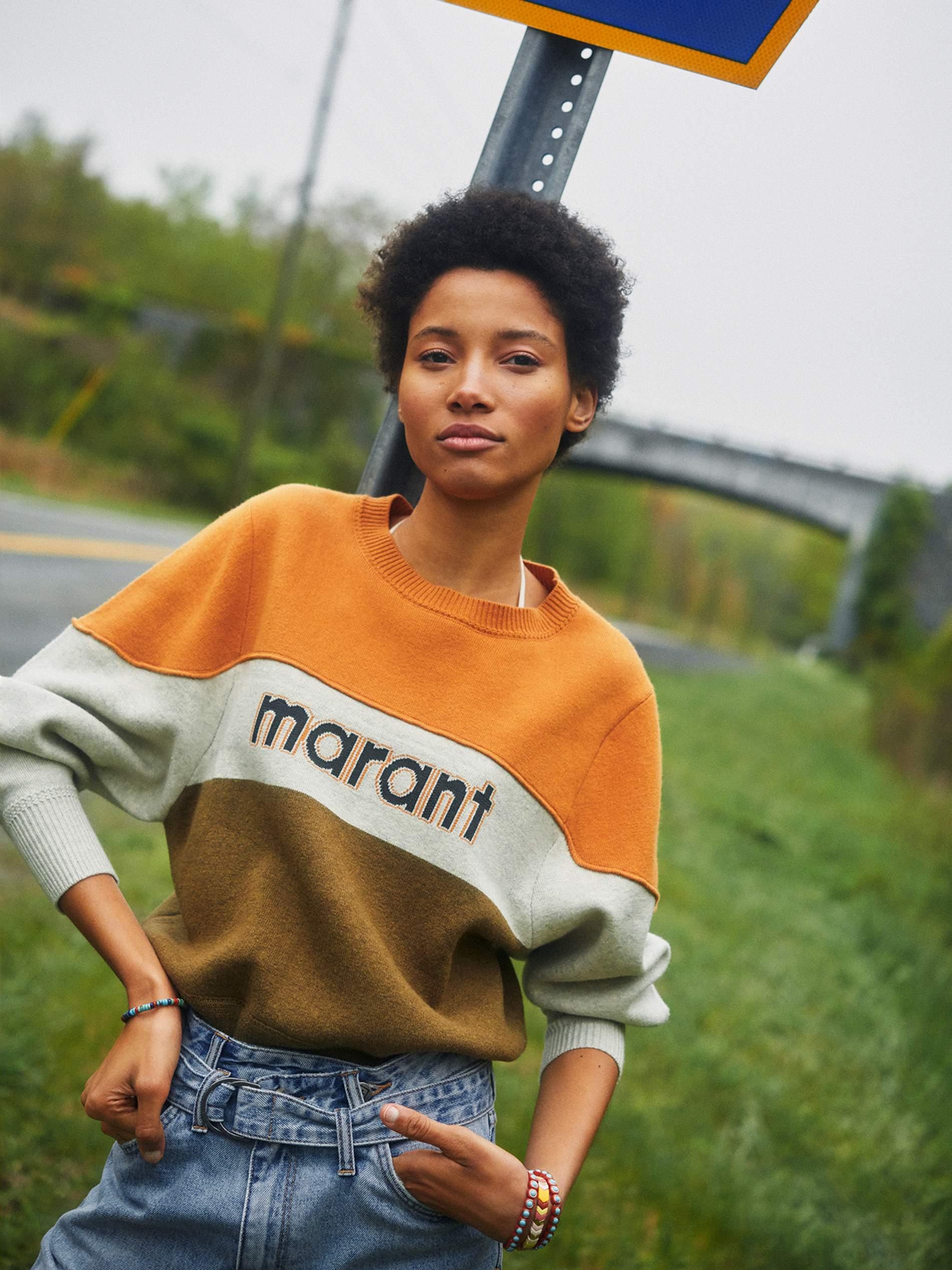 Sweater Isabel Marant Étoile; jeans Ksubi; right arm bracelet Mikia; left arm bracelets  (set of three)  Roxanne Assoulin