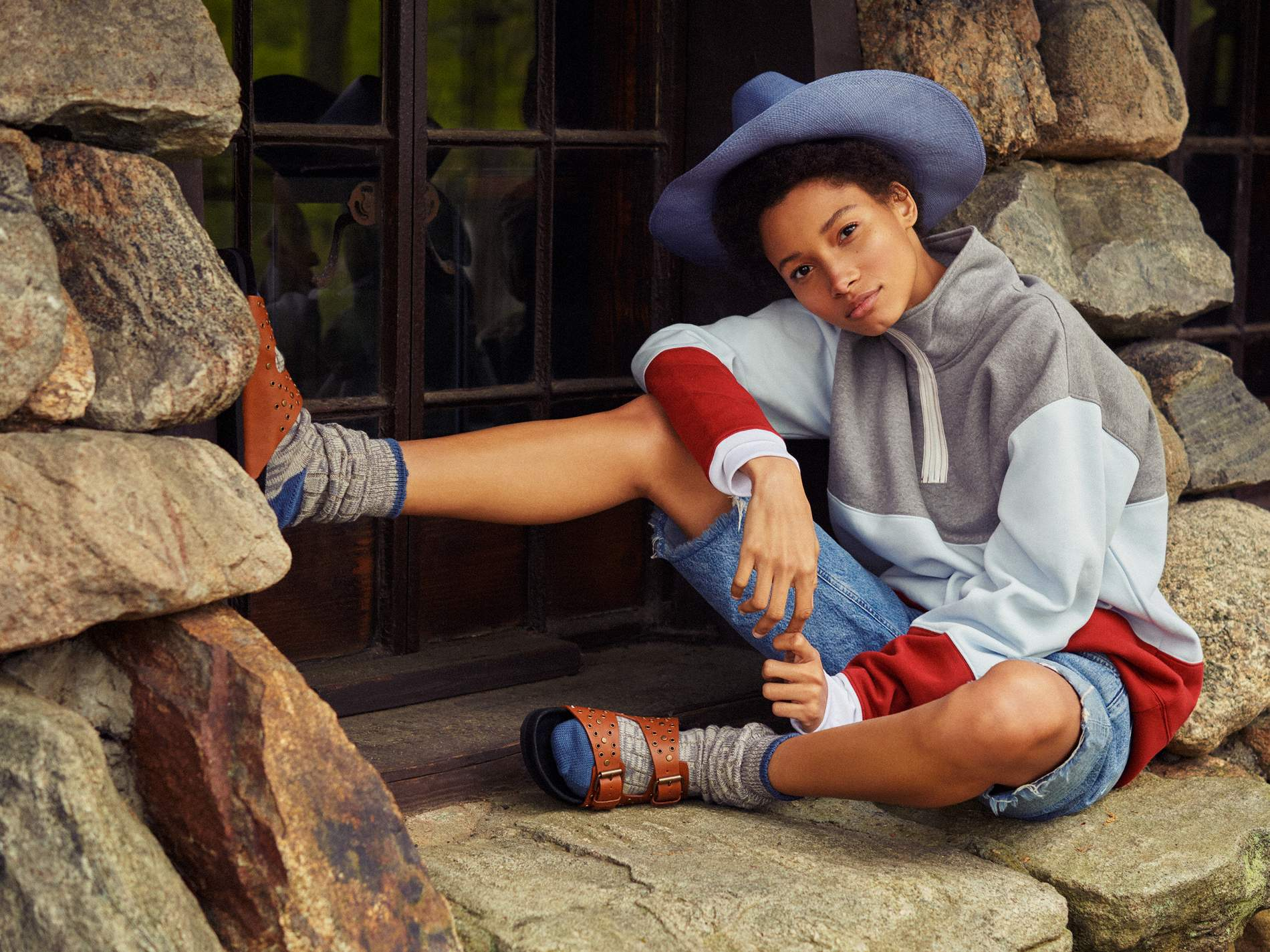 Sweater Acne Studios; shorts Agolde; socks stylist's own; shoes Isabel Marant; hat Clyde.