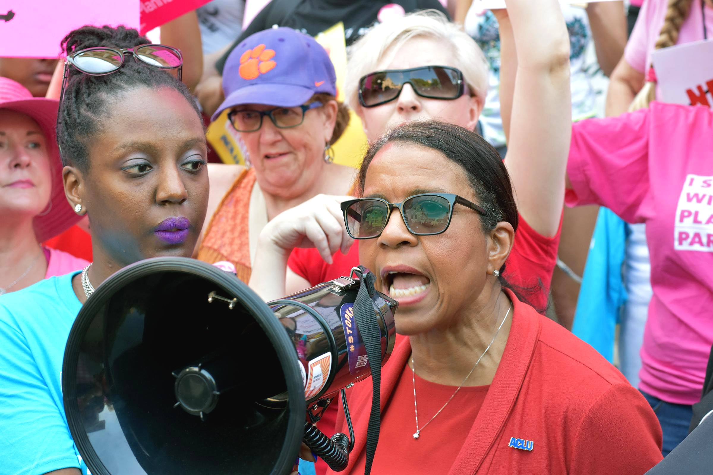 ACLU of Georgia Executive Director Andrea Young speaks into a megaphone at a rally outside of the state capitol building May 21, 2019.