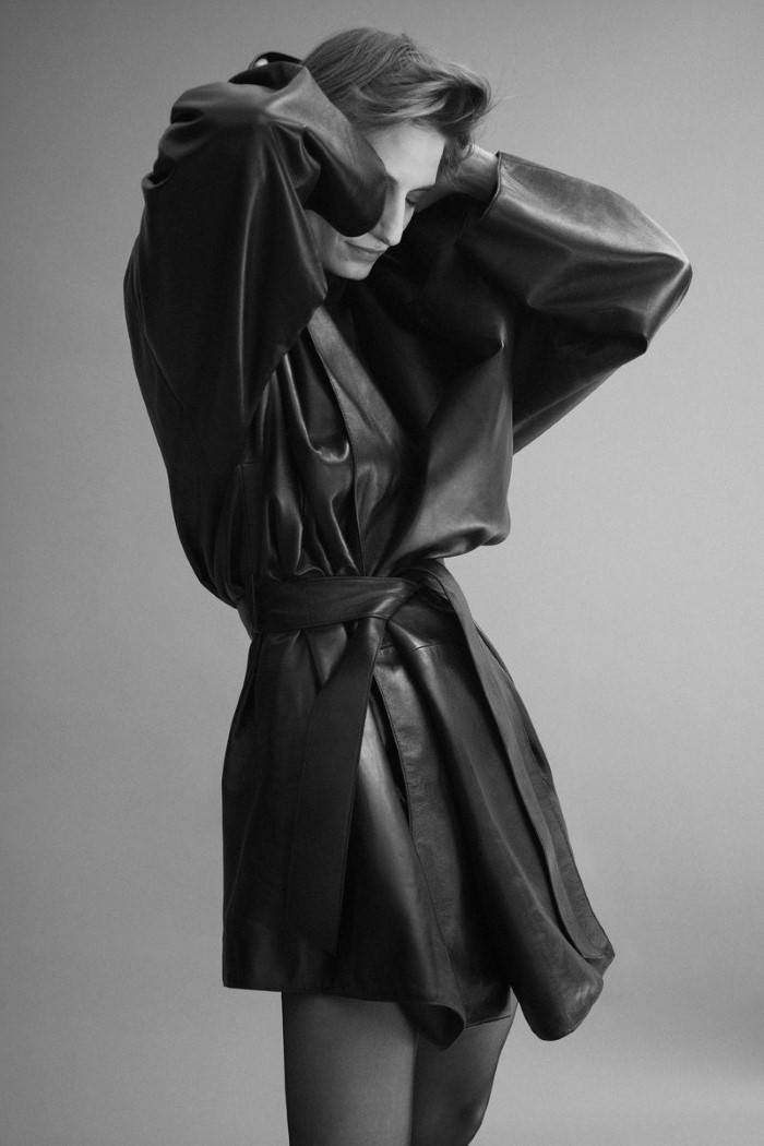 Sleeves are back and bigger than ever, whether draped or ruffled. Balenciaga coat,  $5,200 , and turtleneck,  $650.   Veronika Kunz  by  Bibi Cornejo Borthwick