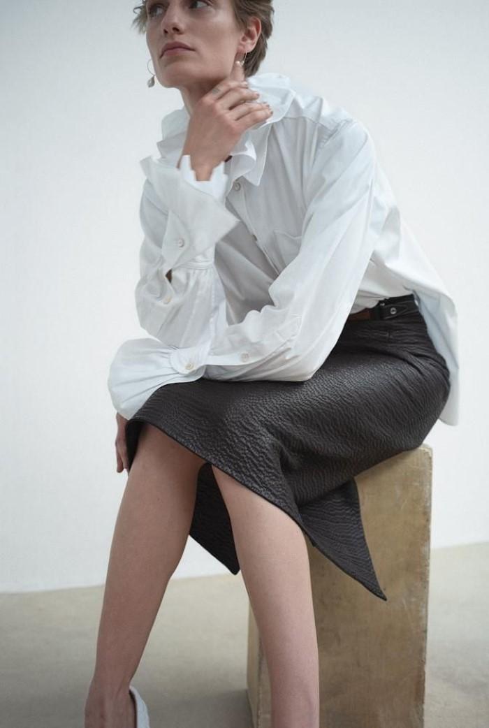 Hillier Bartley blouse,  $900,    matchesfashion.com  , Hermès skirt,  $21,400.   Veronika Kunz  by  Bibi Cornejo Borthwick