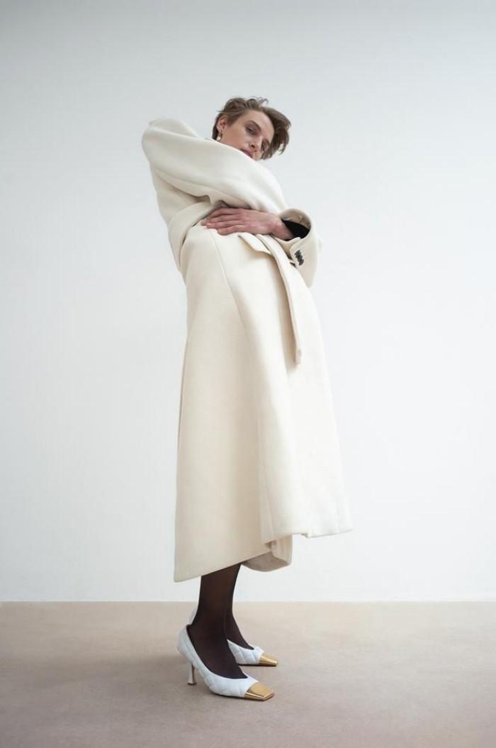 Saint Laurent by Anthony Vaccarello coat,  $4,990 , and dress,  $2,800, Saint Laurent, 3 East 57th Street, New York , Bottega Veneta shoes,  $1,100.   Veronika Kunz  by  Bibi Cornejo Borthwick