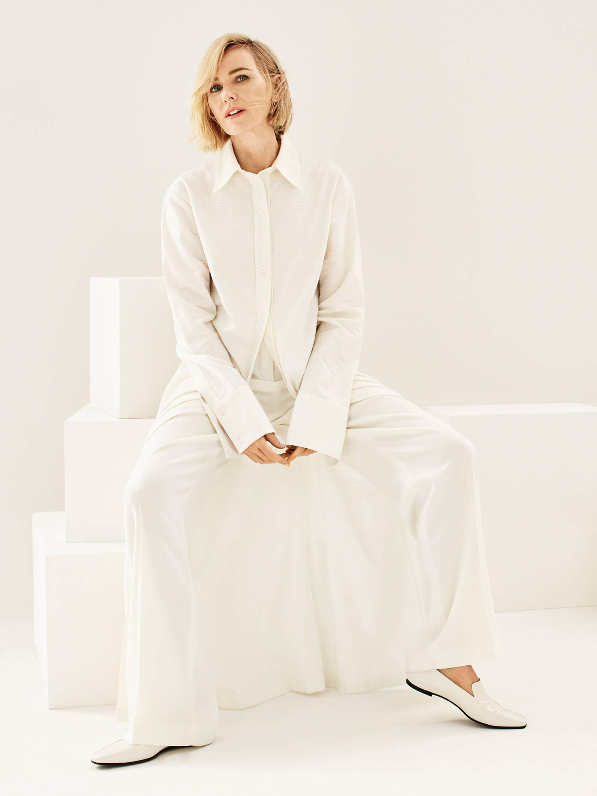 Shirt dress Deveaux; pants Joseph; shoes The Row. Naomi Watts by Jason Kibler for Porter Edit Aug. 2, 2019