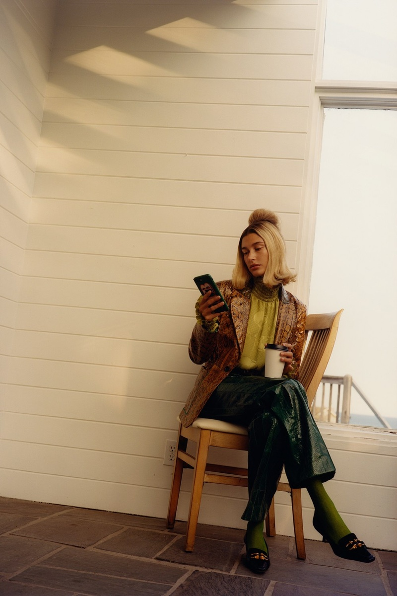 Gucci jacket, top, pants, and belt; Music Legs tights; Bottega Veneta shoes. Hailey Bieber by Colin Dodgson for W Magazine.