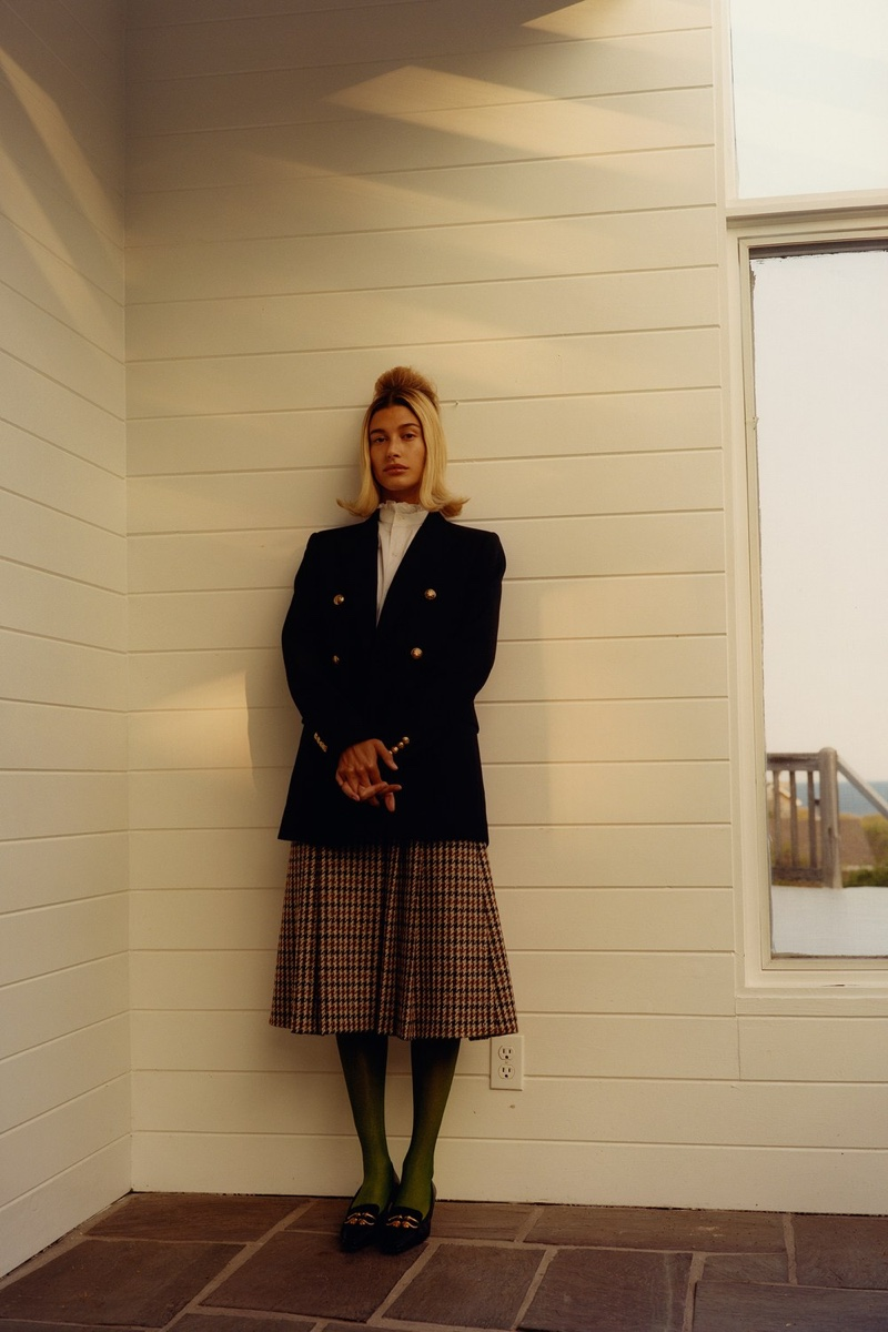 Celine by Hedi Slimane blazer, shirt, and skirt; Music Legs tights; Bottega Veneta shoes. Hailey Bieber by Colin Dodgson for W Magazine.