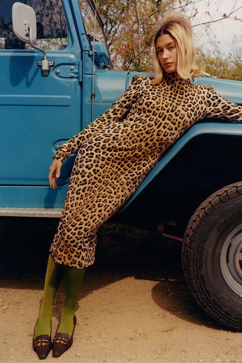 Blumarine dress; Bottega Veneta bracelet and shoes; Music Legs tights. Hailey Bieber by Colin Dodgson for W Magazine.