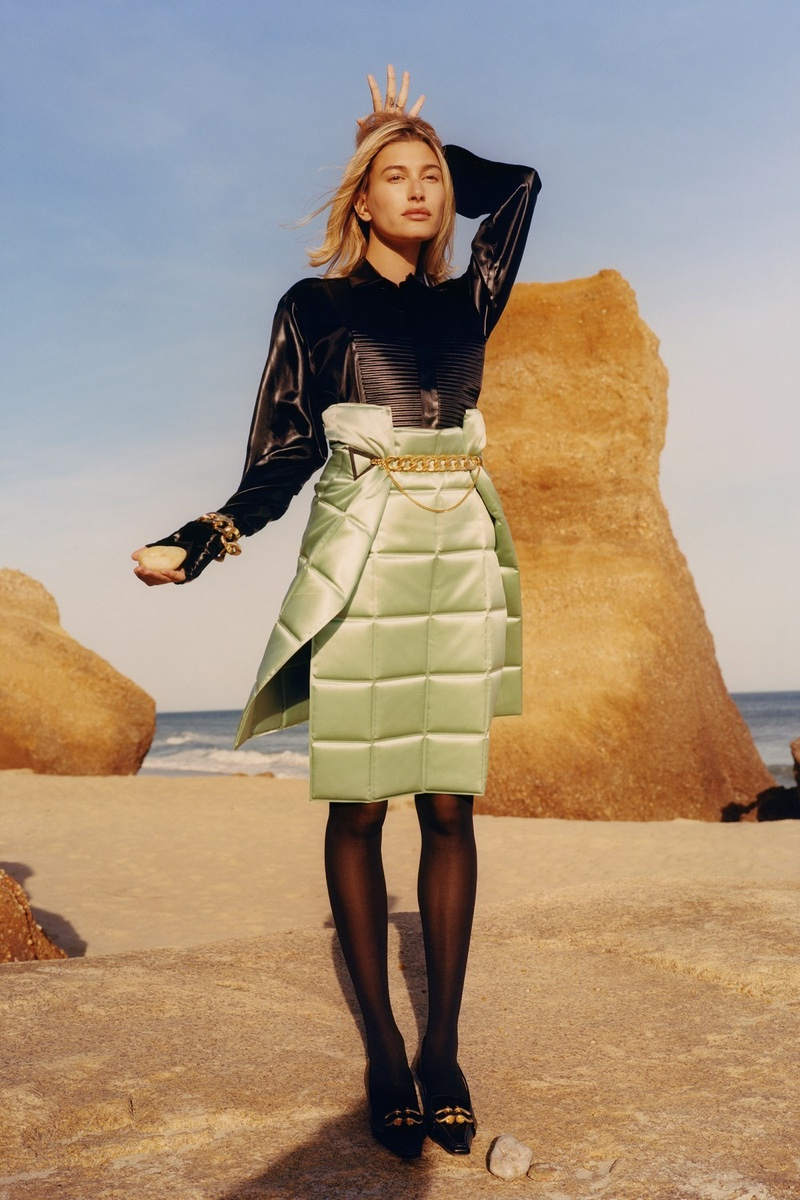 Bottega Veneta shirt, skirt, bracelet, and shoes; Wolford tights. Hailey Bieber by Colin Dodgson for W Magazine.